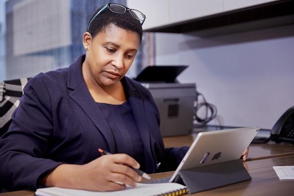Ona Dosunmu working on iPad.