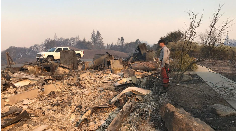 Jake Olsan surveys the scant remains of his family's home in rural Sonoma County, Oct. 2017 (Photo/Courtesy Jeremy Olsan and www.jweekly.com)