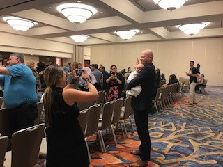San Diego, CA: A new member is sworn in, baby in arms, San Diego, California