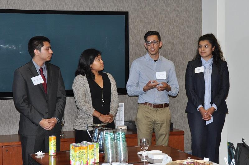 image of Michael Damasco, Idalmis Vaquero, Elias Rodriguez (speaking) and Mina Arasteh.