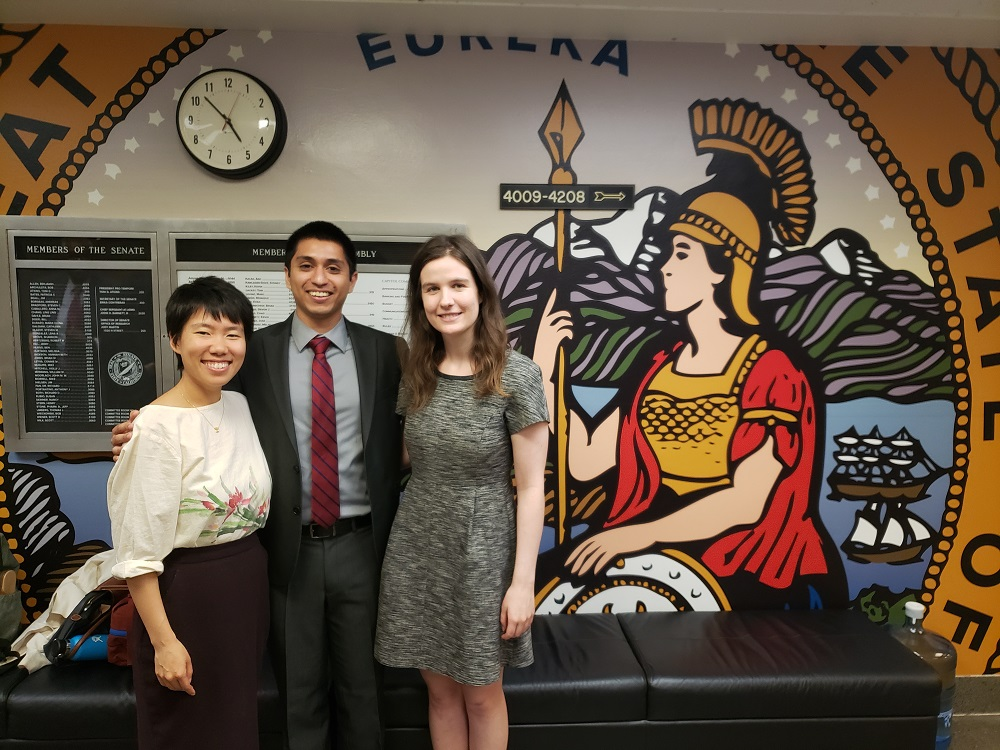 Michael (center) with his CRPE supervisor Chelsea Tu (left) and a CRPE intern