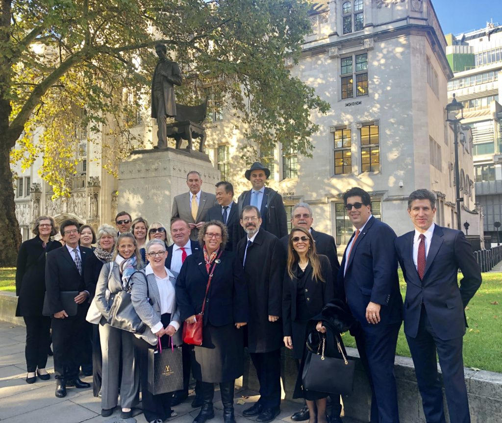 The group about to enter the UK Supreme Court in front of an Abraham Lincoln statue.