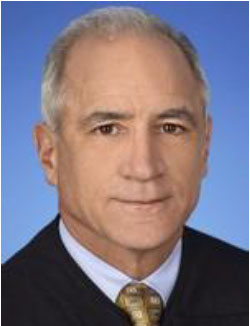 U.S. District Judge Robert Scola