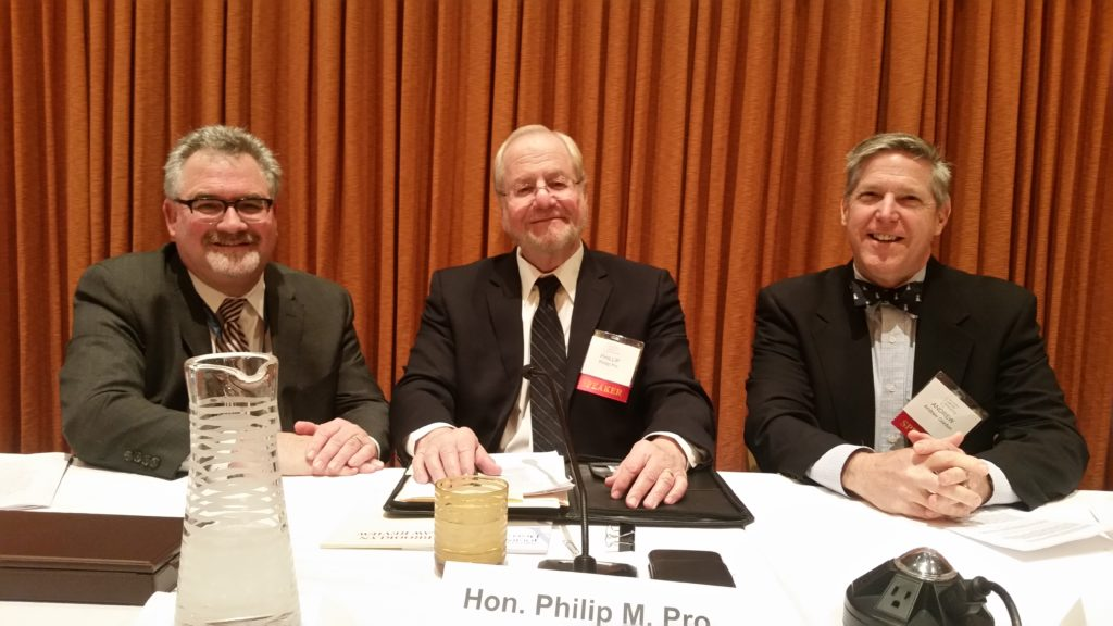 3 speakers at panel table