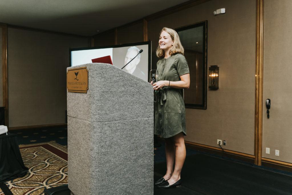 Award recipient speaking at podium stand