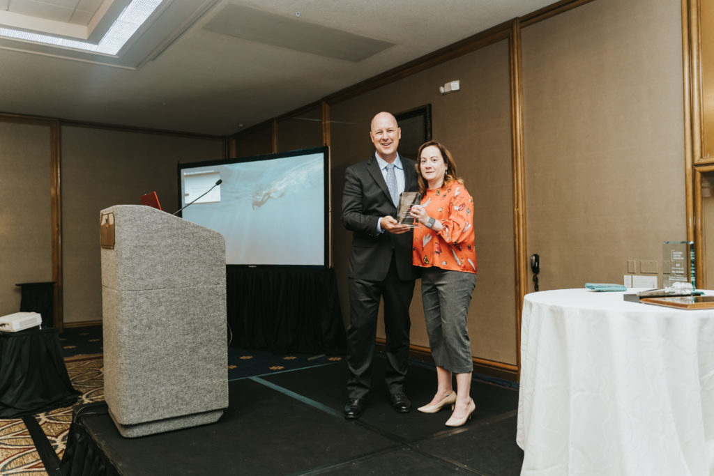 Presenter posing with award recipient