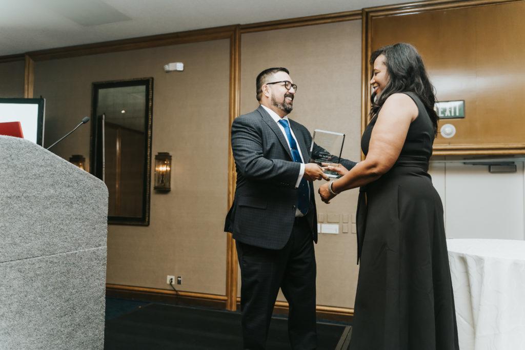 Presenter handing award to recipient