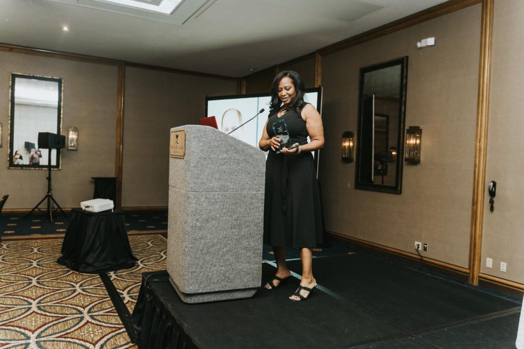 Award recipient at the podium stand