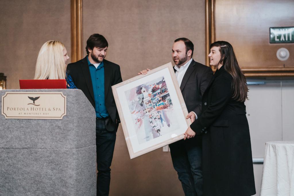 Recipients receiving art photo